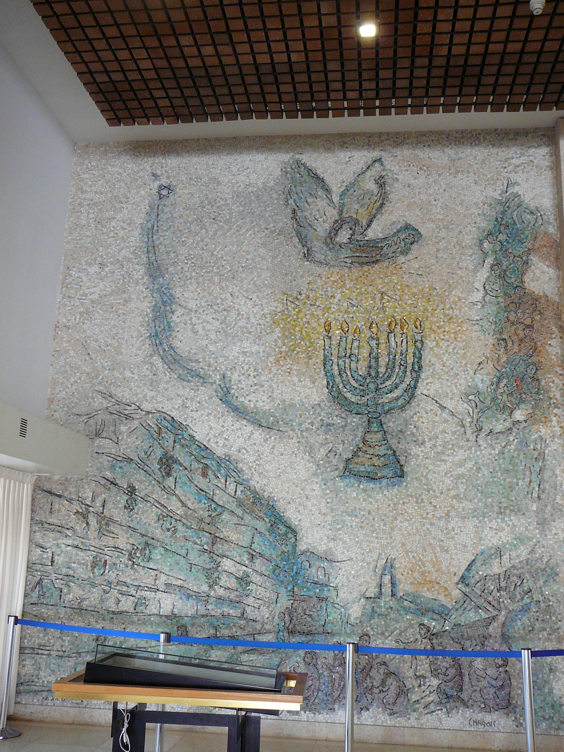 Chagall's interpretation of the Wailing Wall as a great mosaic performed by Italian artists. In the middle appears the angel of salvation, which calls the Jewish people home from the diaspora